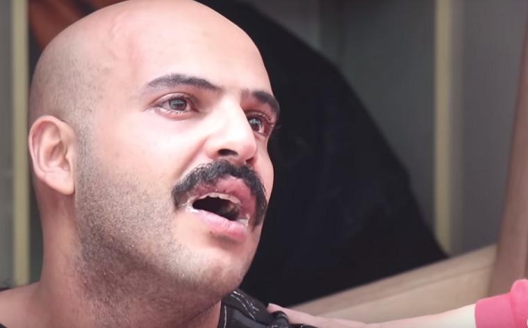 Неадекватный мужчина пытался покончить с собой в центре Киева (видео)